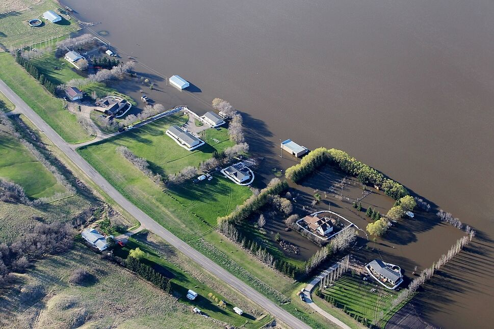 Six homes bordering the south side of Grand Valley Rd. in the RM of Whitehead stand out against the flood waters covering the field and surrounding a few of the homes.
