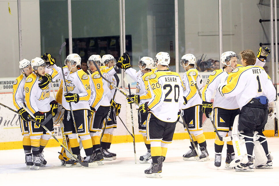 The Brandon Wheat Kings console each other at the end of a 6-0 loss to the Edmonton Oil Kings in game four of their WHL playoff series at Westman Place. The Oil Kings defeated the Wheaties in four straight games. (Tim Smith)