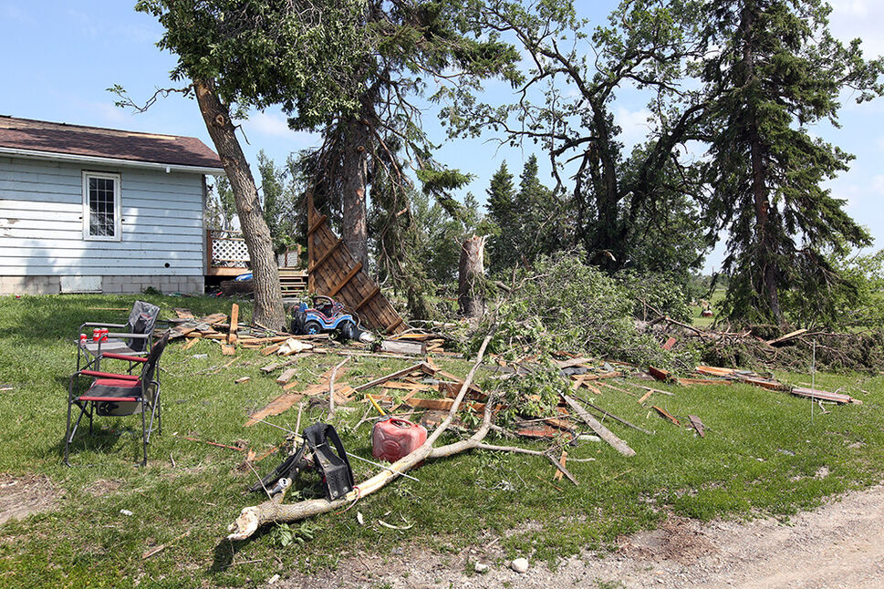 29062020 Trees are snapped like matchsticks at the Inglis farm east of Rapid City on Monday after a powerful storm passed over the area causing widespread damage to a few area farms. The Inglis' home was heavily damaged as were other buildings on the property.   (Tim Smith/The Brandon Sun)