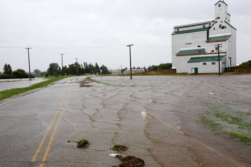 Water pours over Highway 256 just north of the village of Cromer in southwestern Manitoba on Sunday after incessant rainfall over the weekend caused flooding forcing the evacuation of approximately 30 residents.   (Tim Smith/Brandon Sun)