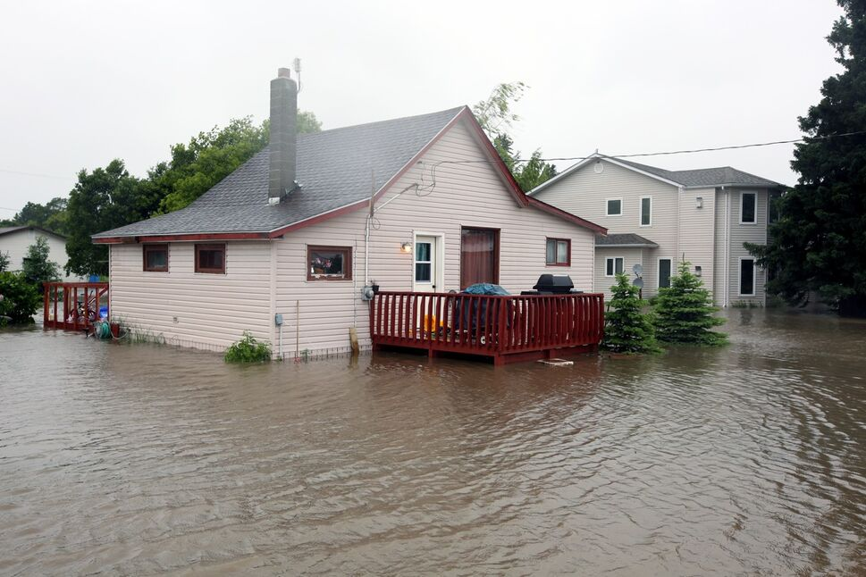 Flood water surrounds homes in the village of Cromer in southwestern Manitoba on Sunday after incessant rainfall over the weekend caused flooding forcing the evacuation of approximately 30 residents. (Tim Smith/Brandon Sun)