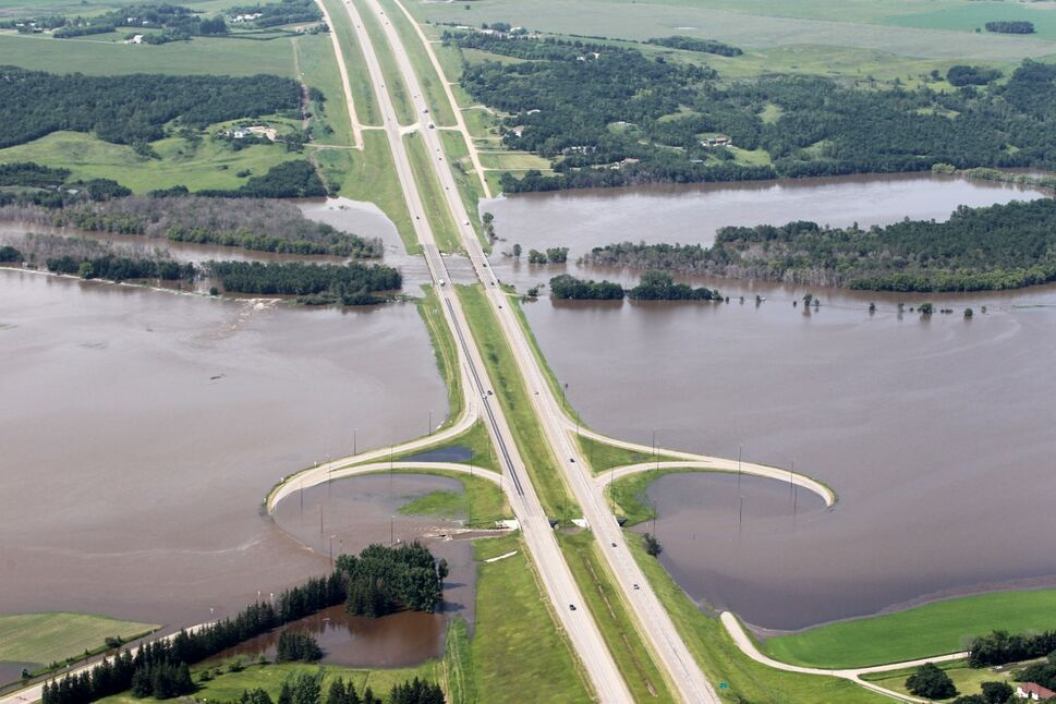 Grand Valley Road and the on/off ramps to the Trans Canada Highway west of Brandon sit under flood water from the rising Assiniboine River on Saturday morning. (Tim Smith/Brandon Sun)