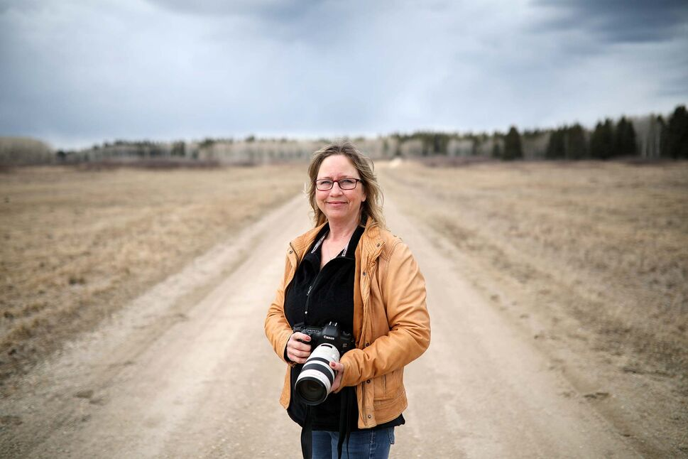 Dauphin based photographer Debora Crammond after photographing plains bison near Lake Audy in Riding Mountain National Park on a warm April day. (Tim Smith/The Brandon Sun)