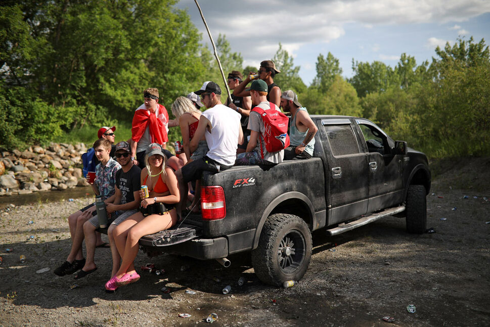 Festival-goers party in a pickup truck on the creek bed that runs next to the Dauphin's Countryfest 2019 site on a scorching hot Friday evening. (Tim Smith/The Brandon Sun)