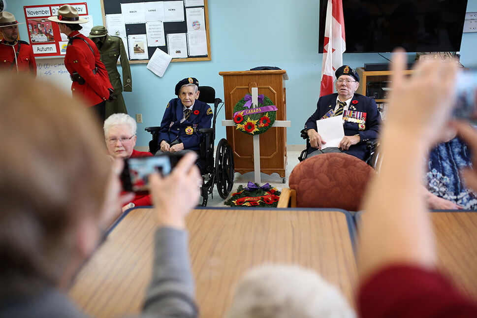 Siblings Jean Daniel, 94, and Jack Houston, 96, have their photo taken together after a Remembrance Day ceremony at the Birch Lodge Personal Care Home in Hamiota on Thursday. Daniel served in Halifax and Houston served in France during the Second World War. They had three other siblings who also served in the Canadian military. (Tim Smith/The Brandon Sun)