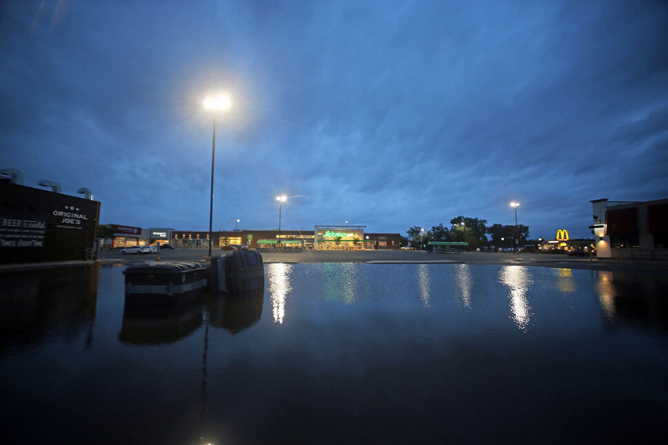 Flooding in the Shoppers Mall parking lot in front of Sobey's early Monday morning. (Matt Goerzen/The Brandon Sun)