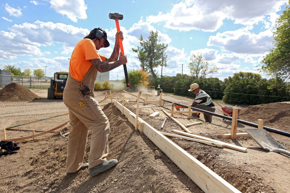 Trevor Moncaster and Brent Eftoda with Beaver Concrete work on building the Virden Skatepark on a warm Tuesday afternoon. The skatepark builders hope to have the park completed by Thanksgiving. (Tim Smith/The Brandon Sun)