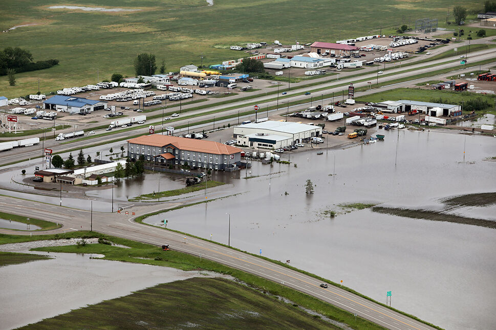 29062020 Overland flooding covers Middleton Avenue near Highway 1 and Highway 10 in Brandon on Monday after heavy downpours Sunday evening into overnight. (Tim Smith/The Brandon Sun)