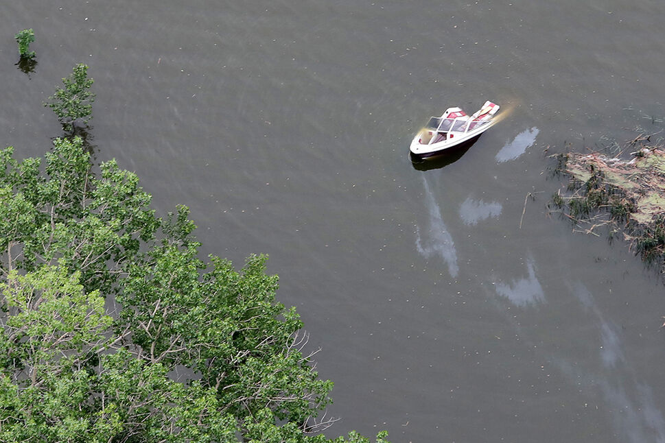 29062020 A boat is seen partially submerged in the Rivers Reservoir on Monday after heavy downpours Sunday evening into overnight caused widespread flooding. . (Tim Smith/The Brandon Sun)