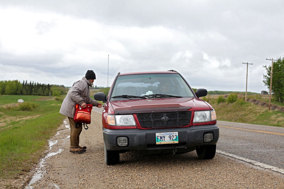 A ride to Brandon appears quickly as Clare hitchhikes on Highway 10. He no longer drives and hitchhikes or walks for his trips into town. He makes it into Erickson most days to check his mail and run other errands. Other days he heads to Brandon.  (Tim Smith/Brandon Sun)