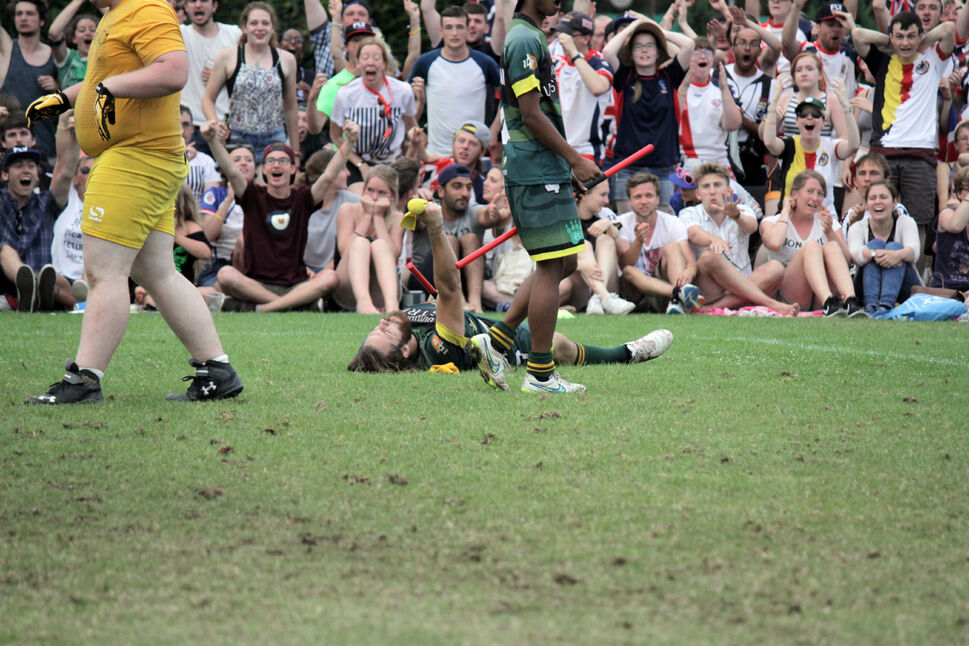 The crowd reacts as Team Australia seeker Dameon Osborn lays on the ground after catching the snitch. (Andrew Nguyen )