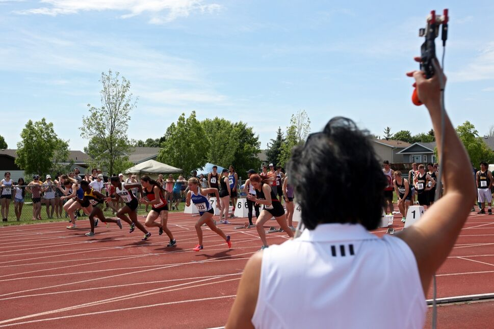 Junior Varsity Girls take off while competing in the 100m event on the opening day of the Provincial Track and Field Championships at the UCT Stadium on a scorching hot Thursday afternoon.  (Tim Smith / Brandon Sun)