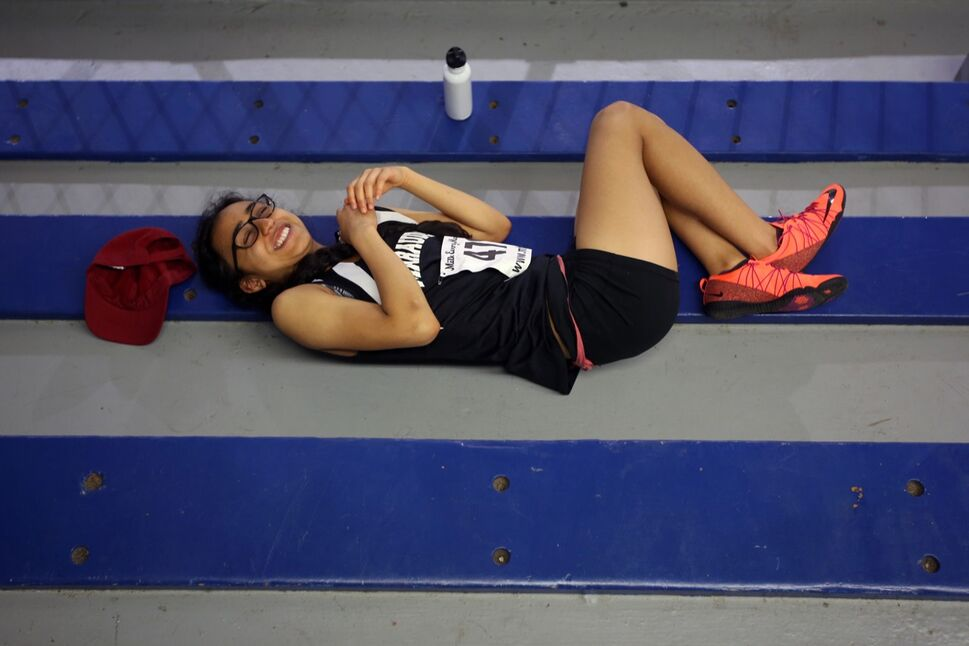 Karan Sidhu of Maples Collegiate rests in the cool confines of the Sportsplex rink while waiting to compete in the medley event on the opening day of the Provincial Track and Field Championships at the UCT Stadium on a scorching hot Thursday afternoon. (Tim Smith / Brandon Sun)