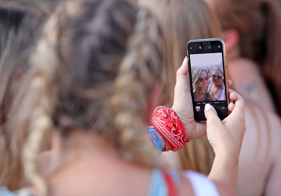 Two women take a selfie together during Madeline Merlo's main stage set at Dauphin's Countryfest 2019 on Friday evening. (Tim Smith/The Brandon Sun)