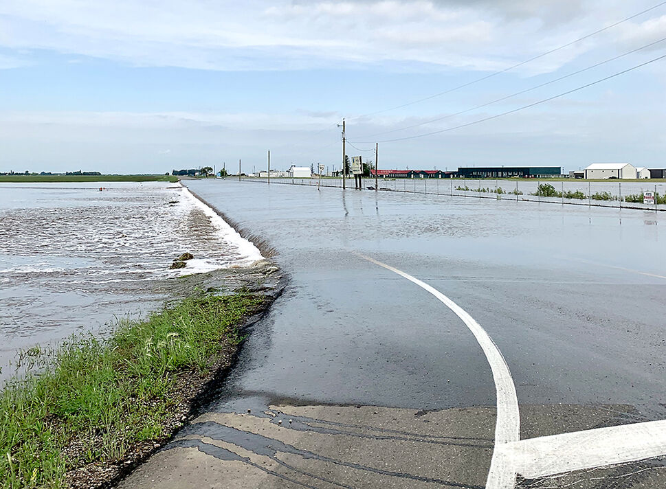 Sandison Road, at the corner of Highway 10 into the Brandon Municipal Airport is flooded. The City of Brandon is recommending a detour. (Courtesy Shannon Saltarelli)