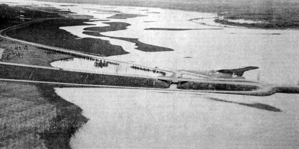 This aerial photograph, taken just west of the Trans-Canada Highway and looking east toward Brandon, shows the extent of flooding along Grand Valley.