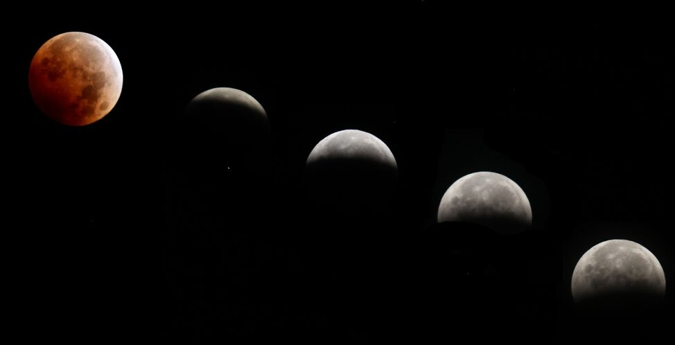 A blood-red moon turns white on Wednesday morning as the Earth's shadow slides away from the lunar surface in this multiple exposure of the lunar eclipse, seen at 20-minute intervals.