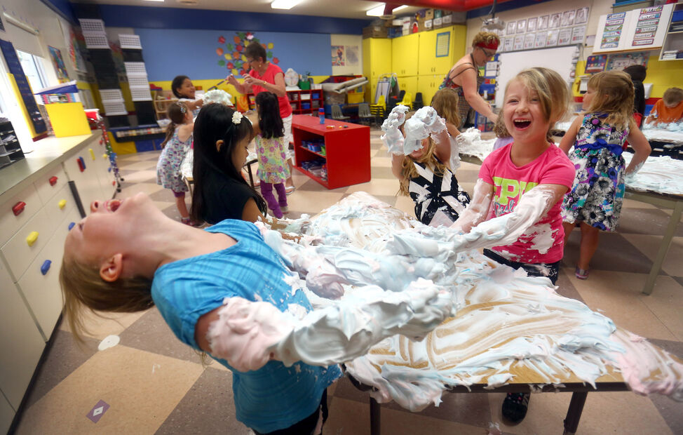 Kindergarten students at St. Augustine School lathered in the their last day of school in June with a shaving cream party. As a yearend treat, students were allowed to express themselves creatively in a way that was easily cleaned up with a little water.