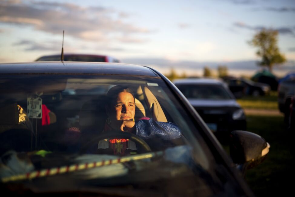 Mark Bolin of Tulsa, Oklahoma watches the pow wow performances from his car at the 2016 Sioux Valley Dakota Nation Pow wow on Saturday evening. Bolin has been up to Canada for pow wow's before but this was his first time in Manitoba.