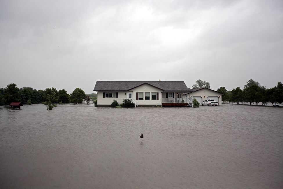 Flood water surrounds a home in the village of Cromer in southwestern Manitoba on Sunday after incessant rainfall over the weekend caused flooding forcing the evacuation of approximately 30 residents.