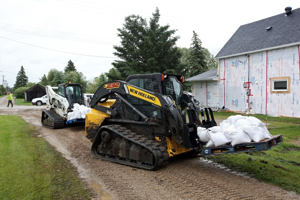 Sandbags are dropped off to build dikes around homes and other key areas in the town of Reston in southwestern Manitoba on Sunday after incessant rainfall creating overland flooding in the community. Reston was hit hard by flooding just over a year ago.