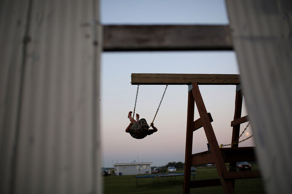 Five-year-old Michael Struss swings beneath the large screen at the Shamrock Drive-In before the sun sets on Friday evening.
