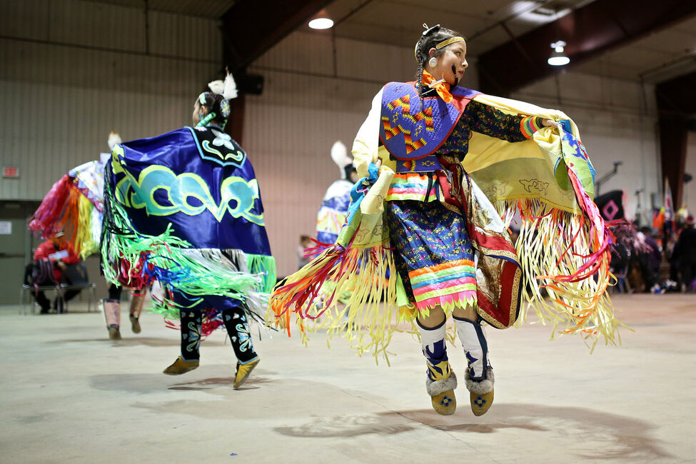 Emilie McKinney of Swan Lake First Nation performs in the fancy shawl category during the Powwow.