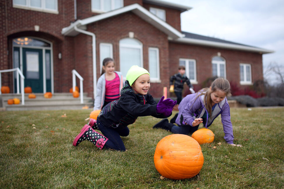 Claira Sttit, 8, rolls a pumpkin down the hill while pumpkin bowling, a Clark family tradition, during Colin's Cancer Kicking Party at his grandparents home outside Brandon. Guests to Colin's part enjoyed food, carnival games, prizes, laser tag and other fun activities.