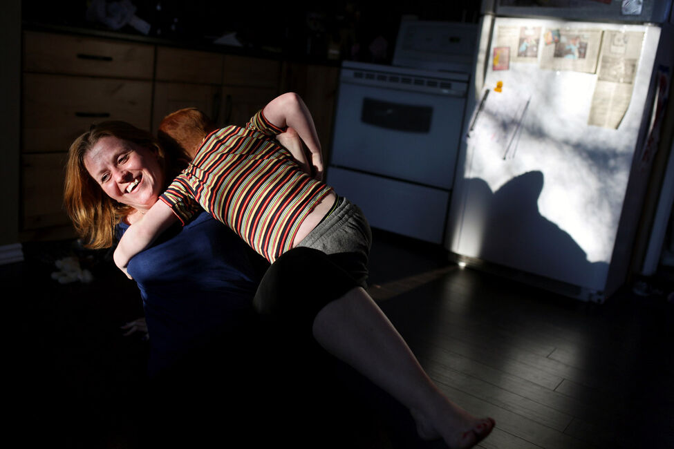 Cheryl and Colin, mother and son bonded by cancer, wrestle on the kitchen floor one evening in April.
