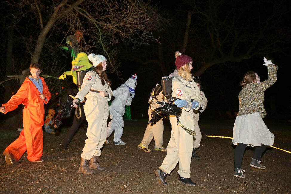 "Performers dance to the ""Ghostbusters"" theme at Grim Acres on Saturday."