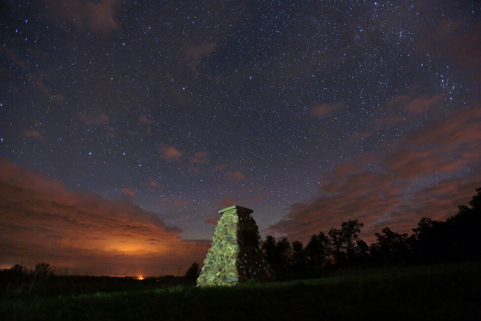Clouds move in from the north during a long exposure that captures the night sky over the stone cairn near Kirkham Bridge on the Little Saskatchewan River on a Wednesday night in September.