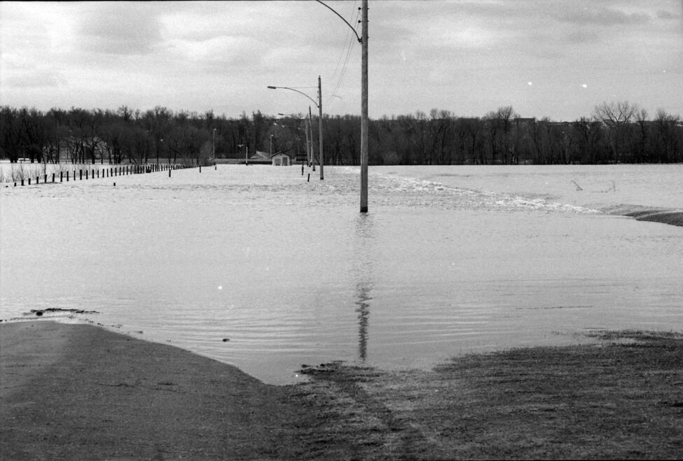 The entrance road to Curran Park, now Turtle Crossing, is completely flooded. (Dirk Aberson / Brandon Sun archives, April 25, 1995)