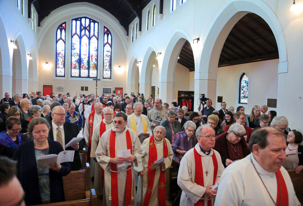 A choir proceeds into the church during a consecration service for the Reverend Canon William Grant Cliff, Tuesday afternoon at St. Matthew's Cathedral. The ceremony allowed Cliff to become a bishop in the Anglican church.