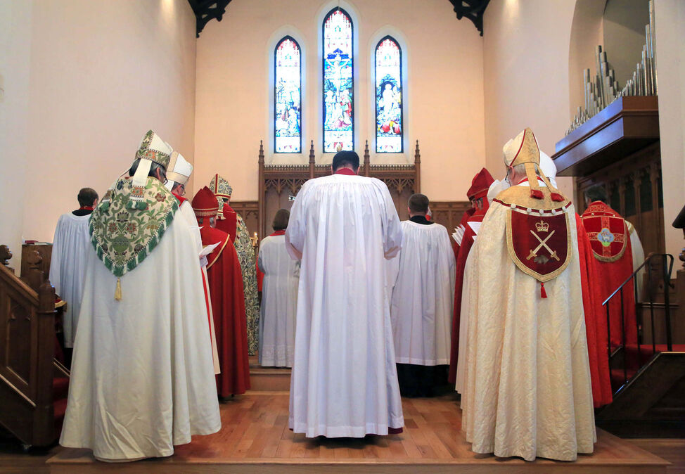 William Grant Cliff, centre, is surrounded by bishops shortly before becoming one himself during a consecration service, Tuesday afternoon at St. Matthew's Cathedral.