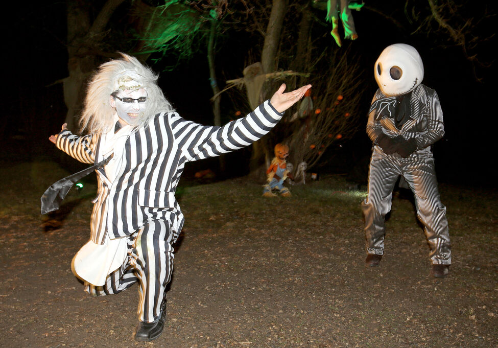 Brian Sutherland dances as Beetlejuice at the Grim Acres Scare Away Cancer fundraising haunted house Halloween night. Sutherland and his wife Amber have been putting on the fundraiser with help from a wide variety of volunteers for five years.