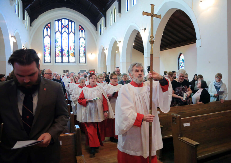 A choir proceeds into the church at the start of a consecration service for the Reverend Canon William Grant Cliff, Tuesday afternoon at St. Matthew's Cathedral. The ceremony allowed Cliff to become a bishop in the church.