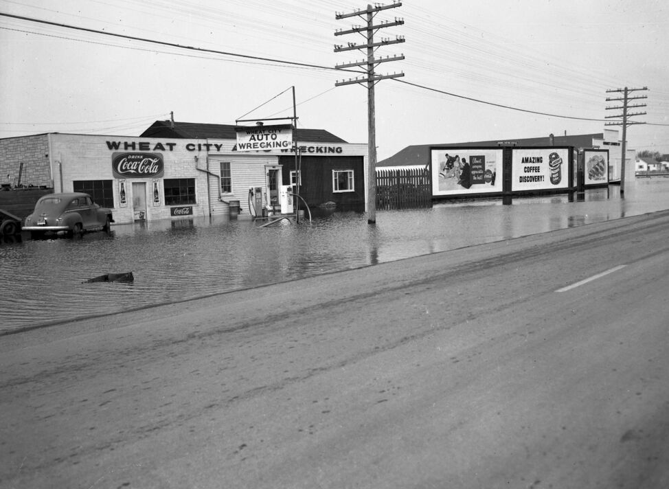 According to the 1954 Henderson Directory, the location of Wheat City Auto Wrecking was either 1080 or 1050 on 18th Street -- between Southern Avenue and Brandon Avenue. Was water really in the ditches that far away from the river? Or does this photo show a different location, closer to the river? Email website@brandonsun.com if you know more.