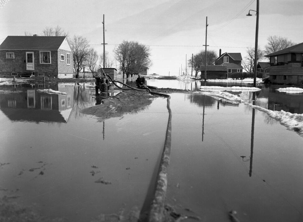 There was no provincial sump pump rebate program in place during the flood of 1954, but some pumps were used to keep floodwaters at bay.