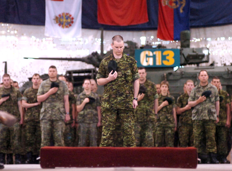 Acting Commanding Officer Maj. Liam McGarry leads his fellow soldiers in a moment of silence for fallen comrade, Capt. Nichola Goddard, during her memorial service at the First Regiment Royal Canadian Horse Artillery at CFB Shilo.