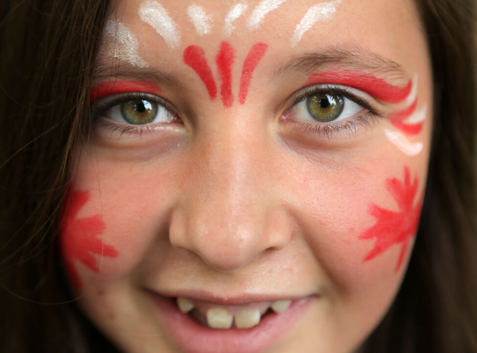 Morgan Boryskiewich shows her painted face during Canada Day festivities at Wasagaming in Riding Mountain National Park.