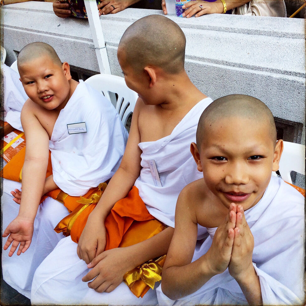 A boy gives a traditional Thai greeting to the camera before he and his friends take their vows to become full-fledged Buddhist monks at a ceremony in Bangkok in April.