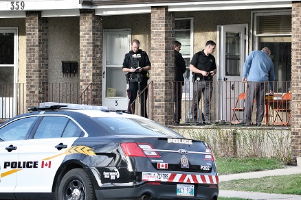 Brandon police investigate an apartment in the 300-block of 13th Street on Tuesday.
