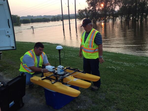 City workers get ready to launch an acoustic doppler profiler on the Assiniboine River in Brandon early Saturday morning, July 12. The device measures the height of the river.