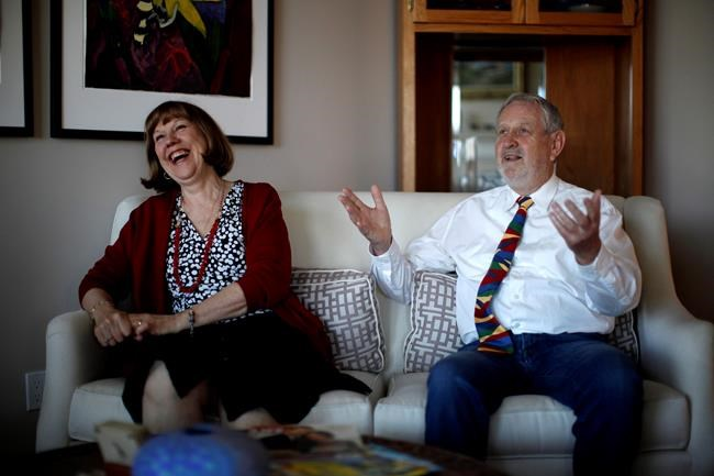 David Spence is the president of the Royal Commonwealth Society and organizer of a wedding reception being held on the same day as Prince Harry and Meghan Markle. He's photographed sharing a laugh with his wife Donna Otto during an interview at home in Brentwood Bay, B.C., on Monday, May 7, 2018. THE CANADIAN PRESS/Chad Hipolito