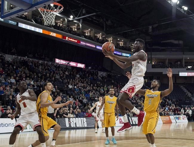 Calgary Dinos&#39 Mambi Diawara centre lays up the winning shot in the last seconds of the gold medal game against the Ryerson Rams during the U Sports men's basketball national championship in Halifax on Sunday