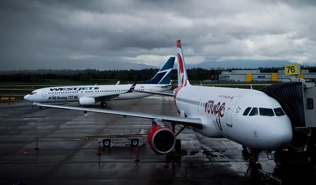 A Westjet Boeing 737-800, left, taxis past an Air Canada Rouge Airbus A319 at Vancouver International Airport in Richmond, B.C., on Monday, April 28, 2014. Here's why your airfare is skyrocketing. Higher gas prices push airfare skyward, prompting a rise in inflation. THE CANADIAN PRESS/Darryl Dyck