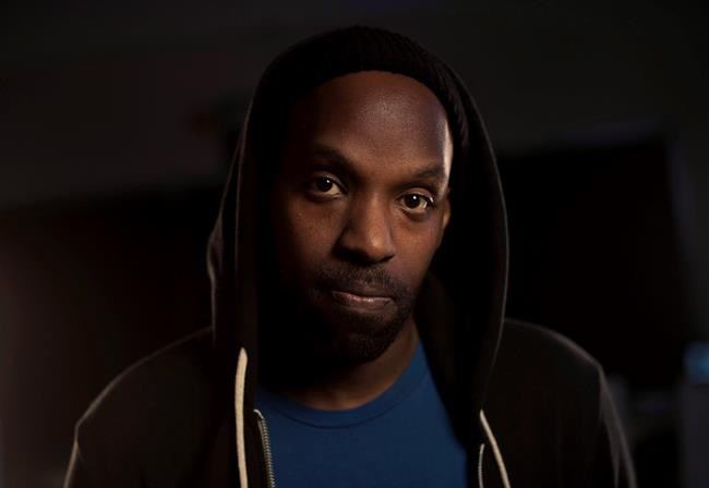 Toronto rapper Shad poses at the CBC headquarters in Toronto on Thursday, March 12, 2015. Canadian hip hop performer Shad is returning to the game with a new album that's stacked with fellow Canadians. THE CANADIAN PRESS/Darren Calabrese