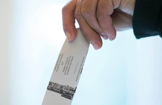 A woman casts her ballot in the riding of Vaudreuil-Soulanges, west of Montreal, on election day, Monday, Oct. 19, 2015. Though there are still months to go before the federal election this fall, the race is on for parties to find and confirm nominees in ridings across the country. THE CANADIAN PRESS IMAGES/Graham Hughes