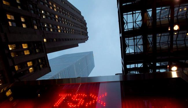 A TSX tote board is pictured in Toronto, on Dec.31, 2012. THE CANADIAN PRESS/Frank Gunn