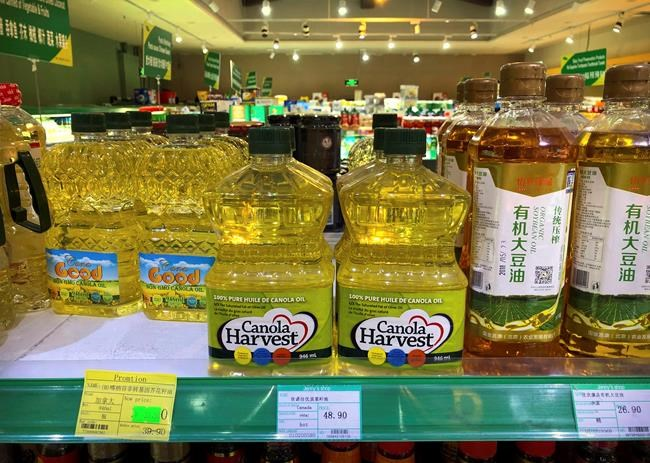 In this March 6, 2019, file photo, bottles of Canola Harvest brand canola oil, manufactured by Canadian agribusiness firm Richardson International, are seen on a shelf of a grocery store in Beijing. China's move to stop buying several Canadian agricultural products has punished some farmers, and now industry leaders are worrying about the prospect of a broader threat - an eventual U.S.-China trade deal. THE CANADIAN PRESS/AP/Mark Schiefelbein